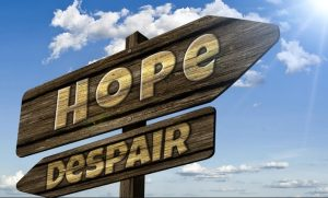 picture of signpost with hope and despair written on it, pointing in opposing directions